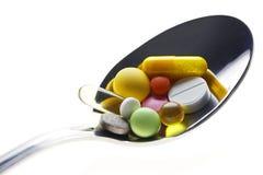 Löffel u. Pillen Stockbilder