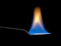 Löffelvoll Feuer, blaue Flamme Verdauungsstörung, medizinisches Konzept Lizenzfreies Stockbild