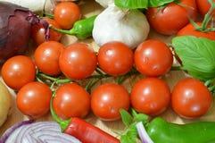 Lökar och tomater Arkivbild