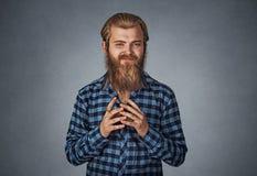 Lömsk beräknande ung man som konspirerar något fotografering för bildbyråer