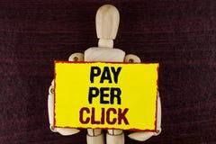 Lön för ordhandstiltext per klick Affärsidé för Get pengar från besökareannonser som annonserar SEO Marketing som är skriftlig på royaltyfri foto