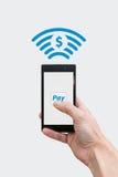 Lön med telefonen - dollarvalutasymbol Fotografering för Bildbyråer