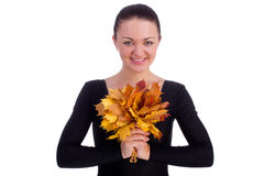 Lönnlöv för orange för flickaholdinghöst arkivbild