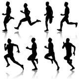Löpare sprintar på, män Arkivbilder