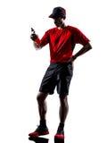 Löparejoggeren som dricker energi, dricker konturn Arkivfoton
