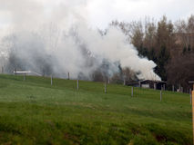Lövfällande förbränning Royaltyfria Bilder