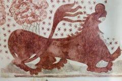Löwe gemalt auf der Wand in einer dänischen Kirche Lizenzfreie Stockbilder