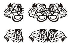 Löwe- und Leopardköpfe in der Stammes- Art Stockbilder