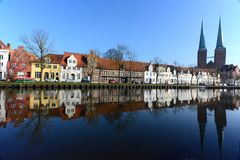 Lübeck, Germany, Malerwinkel. Old historical houses at Lübeck Germany with refelections and church in the background Stock Photo