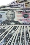 Lügengesicht der Dollarscheine Stockfotos