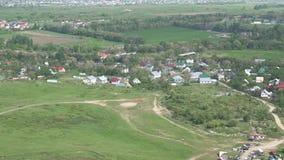 Lądować paraglider Egzekwuje napad w okręgu paragliding Widok od daleko zdjęcie wideo