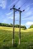 Lądowy elektryczność kabel z słupami Zdjęcie Royalty Free