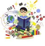 L'écolier a lu un livre Photo stock