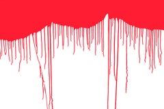 L'écoulement du rouge sur un fond blanc Images libres de droits
