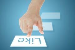 L'écran tactile de pressurage à la main aiment le bouton Images libres de droits