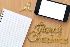 L'écran vide de Smartphone et le texte de Joyeux Noël sont n placé Image libre de droits