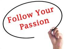 L'écriture de main suivent votre passion sur le conseil transparent Photos libres de droits