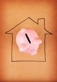 L'épargne à la maison Photos stock