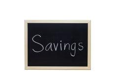 L'épargne écrite avec la craie blanche sur le tableau noir Photo stock