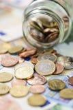 L'épargne dans un de verre (argent européen) Images stock