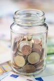 L'épargne dans un de verre (argent européen) Images libres de droits