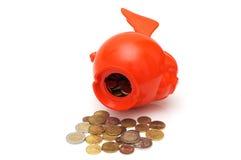 L'épargne de dépense du concept OD avec des pièces de monnaie et porcin Photos stock