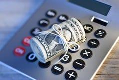 L'épargne de planification de calculatrice d'argent Photographie stock