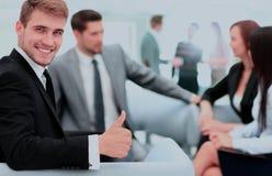 L'équipe d'affaires discutant ensemble prévoit Photos stock