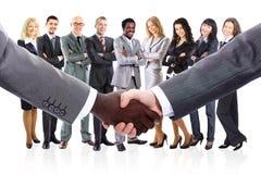L'équipe d'affaires a formé de jeunes hommes d'affaires Image libre de droits