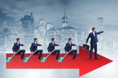 L'équipe d'hommes d'affaires dans le concept de travail d'équipe avec le bateau Photos stock