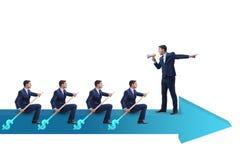 L'équipe d'hommes d'affaires dans le concept de travail d'équipe avec le bateau Photographie stock