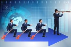 L'équipe d'hommes d'affaires dans le concept de travail d'équipe avec le bateau Image stock