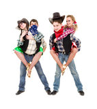 Équipe de danseur de cabaret habillée dans des costumes de cowboy Photo stock