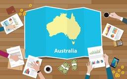 L'équipe de nation de croissance de pays d'économie d'Australie discutent avec la vue de cartes de pli à partir du dessus Images stock