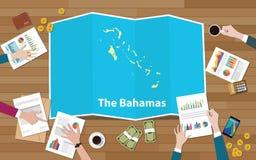 L'équipe de nation de croissance de pays d'économie des Bahamas discutent avec la vue de cartes de pli à partir du dessus Photos stock