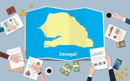 L'équipe de nation de croissance de pays d'économie du Sénégal Afrique discutent avec la vue de cartes de pli à partir du dessus Photo stock