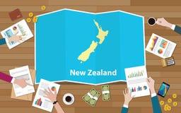 L'équipe de nation de croissance de pays d'économie de la Nouvelle Zélande discutent avec la vue de cartes de pli à partir du des Images stock