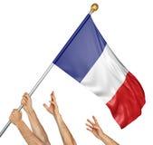L'équipe de peuples remet soulever les Frances drapeau national Image stock