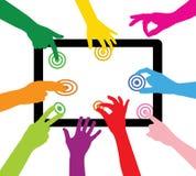 L'équipe touche la tablette Photographie stock libre de droits