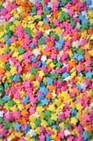 L'étoile colorée arrose Photo libre de droits