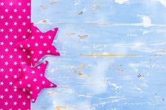 L'étoile faite main forme sur le bois bleu rustique avec l'espace de copie Image libre de droits