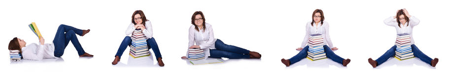 L'étudiant avec des livres d'isolement sur le blanc Photo libre de droits