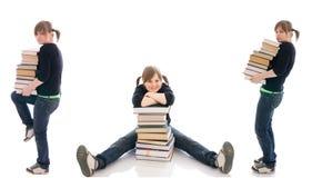 L'étudiant de trois jeunes avec livres d'isolement photographie stock
