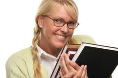 L'étudiant timide porte la pile de livres Photos stock