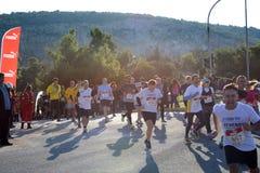 L'événement de puma courent le lac - Athènes, Grèce image libre de droits