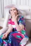 L'aîné féminin actif rit Photos libres de droits