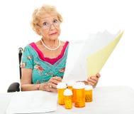 L'aîné handicapé fait face à des charges médicales image stock