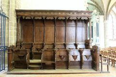 Lonlay Abbey. Normandy France Wooden choir seating royalty free stock image