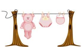 L'abbigliamento delle neonate con l'orsacchiotto riguarda la corda da bucato illustrazione di stock