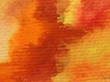 L'abrégé sur fond d'art d'aquarelle frotte l'imagination brouillée texturisée matérielle chaude jaune rouge de lavage humide de d Photo libre de droits